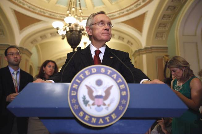 Senate Majority Leader Sen. Harry Reid of Nev. pauses during a news conference on Capitol Hill in Washington, Monday, Aug. 1, 2011, to talk about debt ceiling legislation.