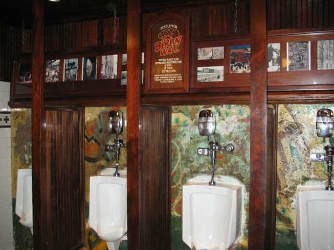 The urinals in the men's room at Main Street Station are set into a portion of the Berlin Wall.