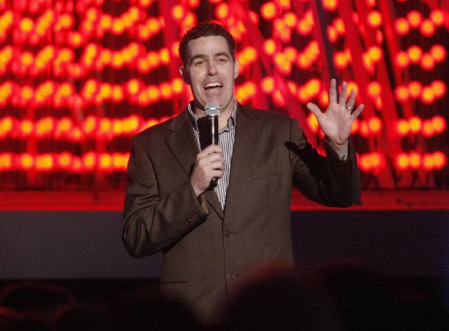 Comedian Adam Carolla hosts the LA Live entertainment complex holiday tree lighting ceremony in Los Angeles on Thursday, Dec. 4, 2008.