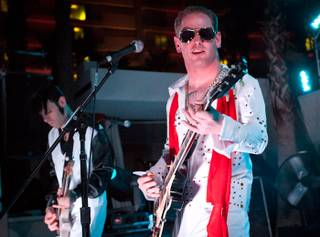 Corey Taylor, dressed as Elvis Presley, and his band perform poolside at the Beach Club at the Hard Rock Hotel on Aug. 5, 2011.