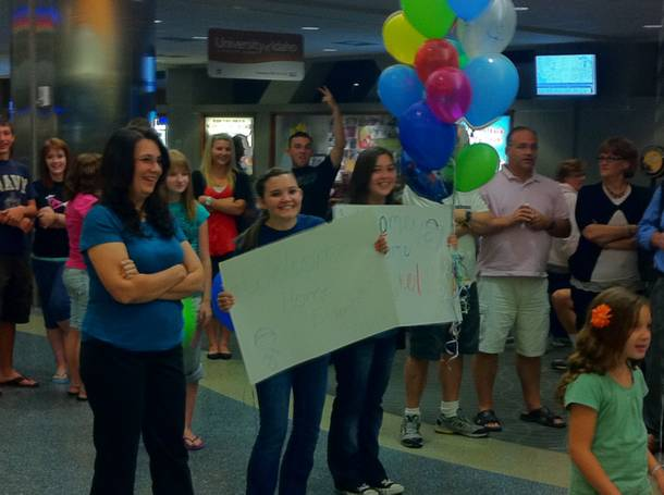 My fans greet me at Boise International Airport. Or maybe they were greeting the servicemen who walked out behind me ...