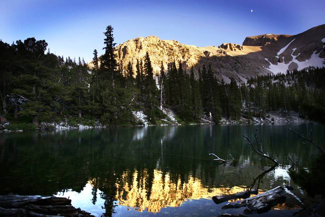 Wheeler Peak is seen reflected in Teresa Lake near sunset at Great Basin National Park on Saturday, Aug. 6, 2011.