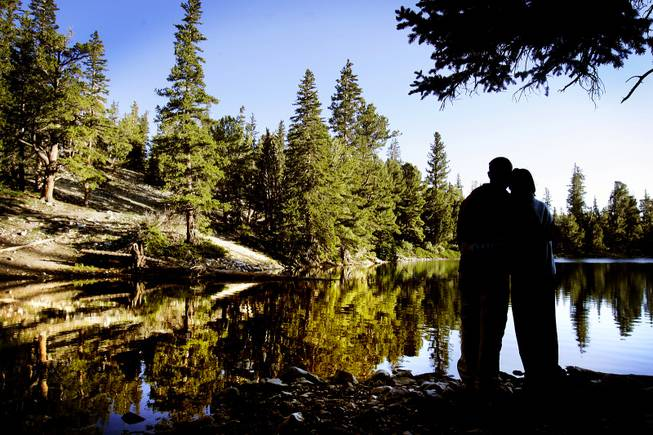 Mark Blais and Nicole Tassone of Las Vegas enjoy Teresa Lake after sunrise at Great Basin National Park on Sunday, August 7, 2011.