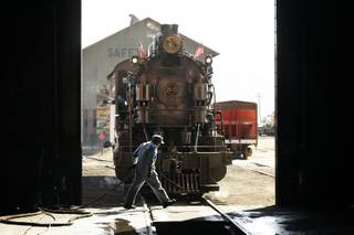 Train master Adam Nini prepares the 1909 steam powered locomotive for the train ride outside the machine shop at the Nevada Northern Railway Museum in Ely Monday, August 8, 2011.