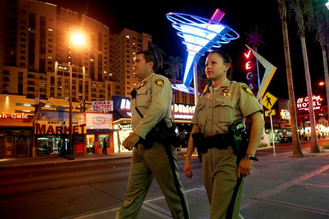Metro Police Officers Bryce Jones and Rachel Calderon patrol Fremont Street in downtown Las Vegas on Monday, Aug. 8, 2011, as part of an initiative called Crime Free Corridor, a plan to reduce crime downtown.