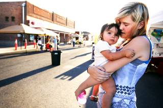 Tabitha Johnson, 16, holds her one-year-old niece Jordan Brazil while shopping at the Center Street Market in downtown Fallon Tuesday, August 9, 2011.