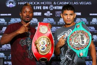 IBF bantamweight champion Joseph Agbeko, left, of Ghana and Abner Mares of Mexico pose during a news conference at the Hard Rock Hotel on Thursday, Aug. 11, 2011. Agbeko will defend his title against Mares at the resort Saturday.