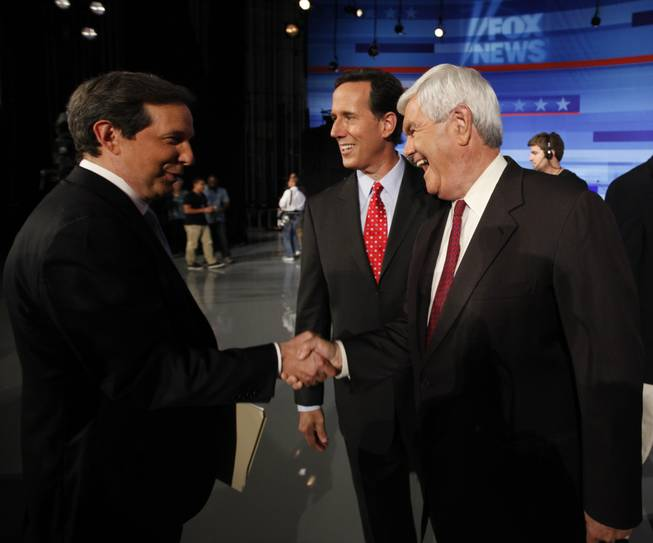 Republican presidential candidates former House Speaker Newt Gingrich and former Pennsylvania Sen. Rick Santorum greet Fox News' Chris Wallace at the end of the Iowa GOP/Fox News Debate at the CY Stephens Auditorium in Ames, Iowa, Thursday, Aug. 11, 2011.