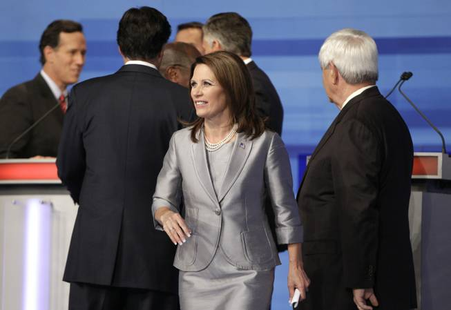 Republican presidential candidate Rep. Michele Bachmann, R-Minn. walks away from her fellow GOP candidates at the end of the Iowa GOP/Fox News Debate at the CY Stephens Auditorium in Ames, Iowa, Thursday, Aug. 11, 2011.