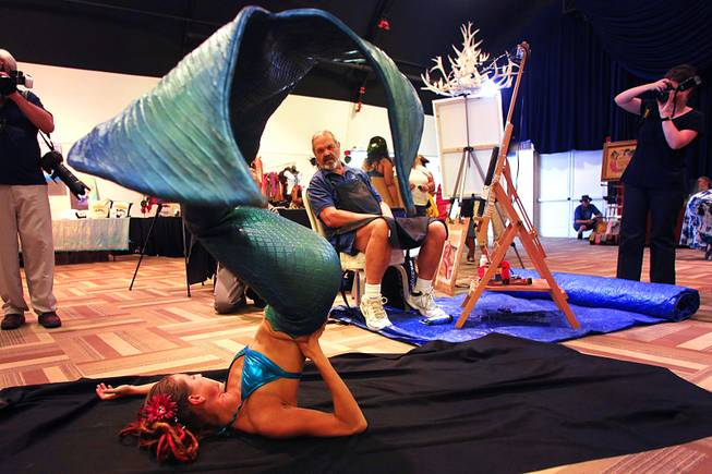 Adelaide Marcus poses for artist Rafael Gonzales during the first annual MerCon mermaid convention Friday, Aug. 12, 2011, at the Silverton.