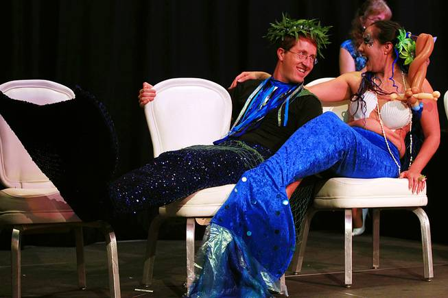 Merman Chris Hervey and mermaid Rachel Rehmet joke around during the first International Mermaid Pageant held as part of MerCon 2011 at Silverton Casino Lodge on Friday, Aug. 12, 2011.
