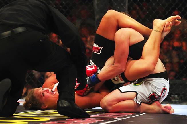 Ronda Rousey questions referee Herb Dean while catching Sarah D'Alelio in an armbar at Strikeforce Challengers Friday, August 12, 2011 in the Pearl Theater at the Palms. Rousey won by submission.