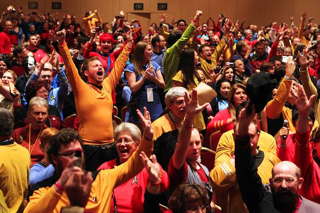 Convention attendees celebrate setting a new record for the largest gathering of people dressed as Star Trek characters at the annual Las Vegas Star Trek convention Saturday, August 13, 2011 at the Rio. Convention attendees nearly doubled the record, setting a new mark of 1040 people in costume.