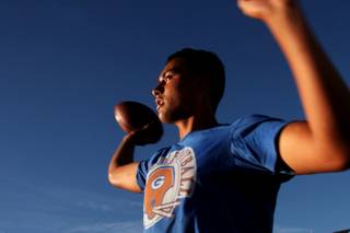 Bishop Gorman junior quarterback Anu Solomon, shown during practice Tuesday, August 16, 2011, is on track to shatter every significant Nevada passing record this season. He is one of 26 athletes on the preseason All-Sun team.