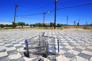 A shopping cart sits in an empty lot on Water Street in Henderson on Tuesday, Aug. 16, 2011.
