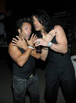 Criss Angel, right, with <em>Believe</em> co-star Maestro, launches MagicPlace.com at Bare Pool Lounge at the Mirage on Aug. 15, 2011.