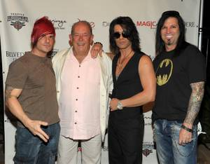 Criss Angel, second from right, with Klayton, Robin Leach and Michael Godard, launches MagicPlace.com at Bare Pool Lounge at the Mirage on Aug. 15, 2011.