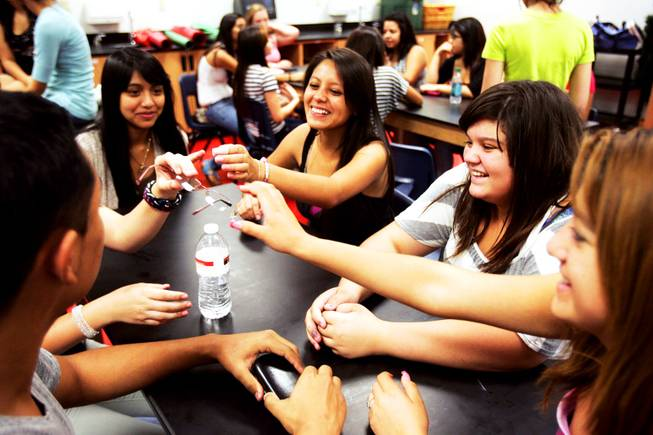 Student council member and junior Brenda Vargas, clockwise from center, sophomore Isabella Munguia, junior Betzabe Sanchaz and junior Alan Rivas joke around during a student council retreat at Western High School in Las Vegas Friday, August 19, 2011.