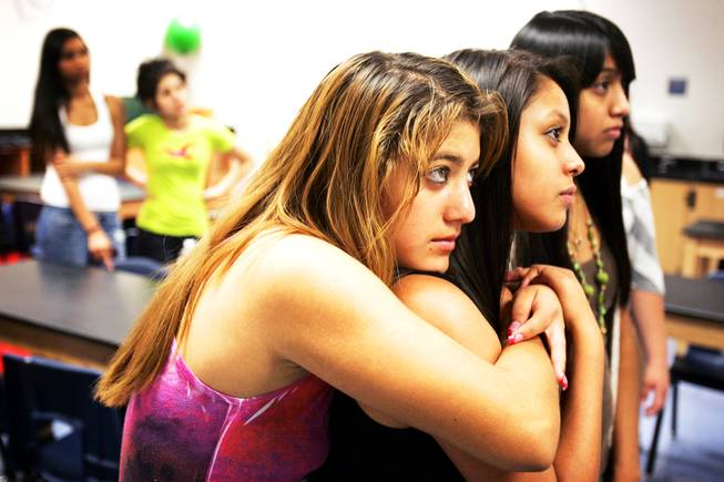 Juniors and student council members Betzabe Sanchaz, left, and Brenda Vargas listen during a student council retreat at Western High School in Las Vegas Friday, August 19, 2011.