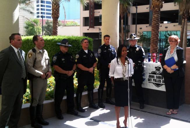 Darlene Adams speaks about the dangers of driving under the influence of prescription drugs at a kickoff press conference outside the Clark County Detention Center for the annual Labor Day impaired driver enforcement effort.