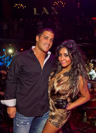 Snooki, with Jionni LaValle, hosts at LAX in the Luxor on Aug. 20, 2011.