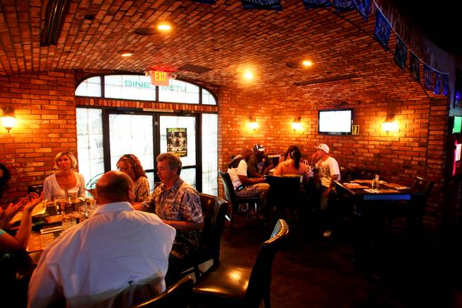 Chaparral alumni and supporters have dinner during a fundraiser hosted by the school's alumni association at Murphy's Law Pub and Grill in Las Vegas Saturday, August 20, 2011. The money raised is to update equipment and help the new coach turn the program around.