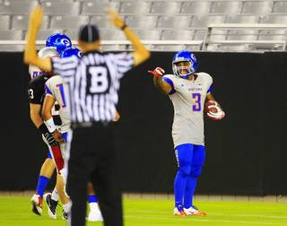 Bishop Gorman running back Shaquille Powell points after one of his six touchdowns during their game against Chaparral High of Scottsdale at the Sollenberger Classic Saturday, August 20, 2011 at the University of Phoenix Stadium in Glendale, Arizona. Gorman beat the defending Arizona 5A state champions 42-22.