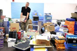 Principal Keith France tries to organize a room full of school materials in preparing for the first day of classes at Elizondo Elementary School in North Las Vegas on Tuesday, Aug. 23, 2011.