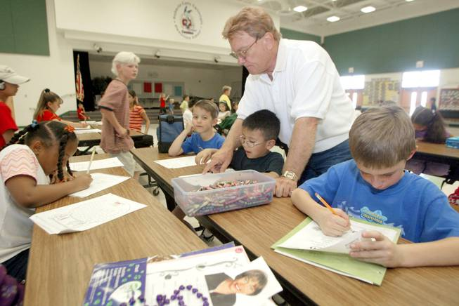 Cartwright Elementary students work on their homework during a SafeKey program after school on June 4, 2002.