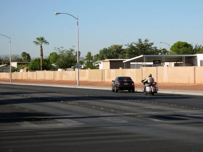 A Metro Police officers stops a motorist Tuesday near Richard Rundle Elementary School.