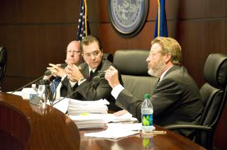 Nevada Gaming Commissioner John Moran Jr. asks attorney Patty Becker and Michael Eide, representing Dotty's Gaming & Spirits, a series of questions regarding the establishment, Thursday, Aug. 25, 2011. The commission heard arguments by Dotty's regarding a change to state gaming regulations.
