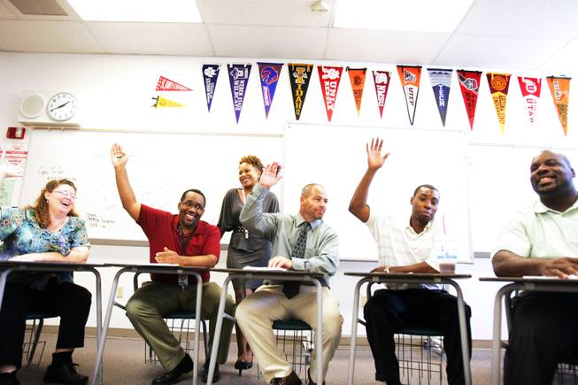 Math teachers raise their hands to vote during a department meeting at Mojave High School in North Las Vegas on Wednesday, August 24, 2011.