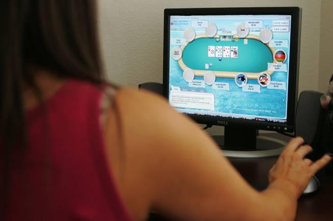The state Gaming Control Board on Wednesday, Aug. 24, 2011, issued a draft of proposed regulations governing Internet poker. In this file photo, a woman who wished to remain anonymous plays online.