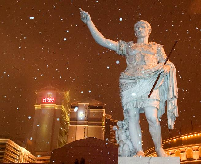 Snow falls around a statue of Caesar in front of Caesars Palace early Tuesday, December 30, 2003.