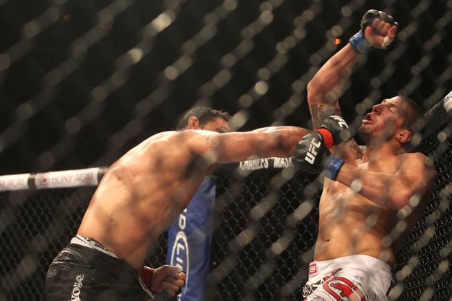 Antonio Rodrigo Nogueira knocks out Brendan Schaub in the first round of their heavyweight bout at UFC 134 in Rio de Janeiro.
