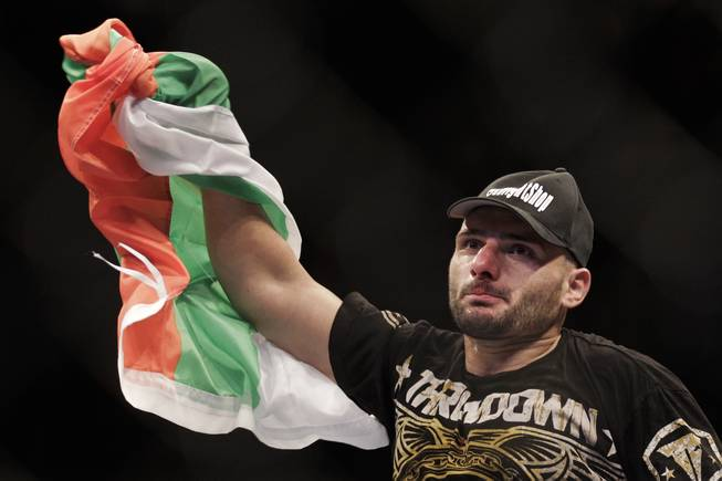 Stanislav Nedkov waves the Bulgarian flag after beating Luiz Cane via first round knockout at UFC 134 in Rio de Janeiro. Nedkov was the only foreigner to beat a Brazilian on the card.