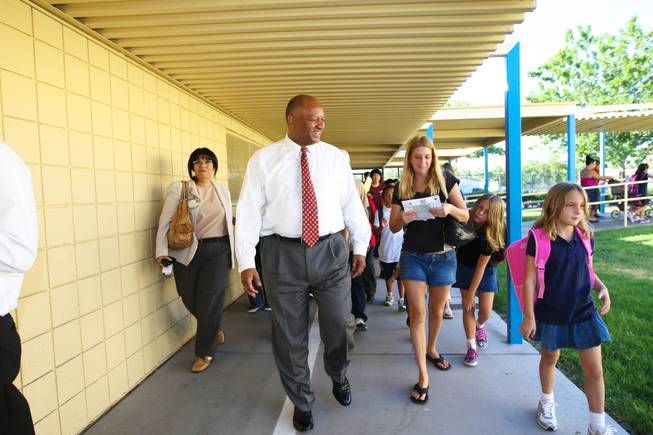Superintendent Dwight Jones takes a tour of Rex Bell Elementary School with students on the first day of classes on August 29, 2011.