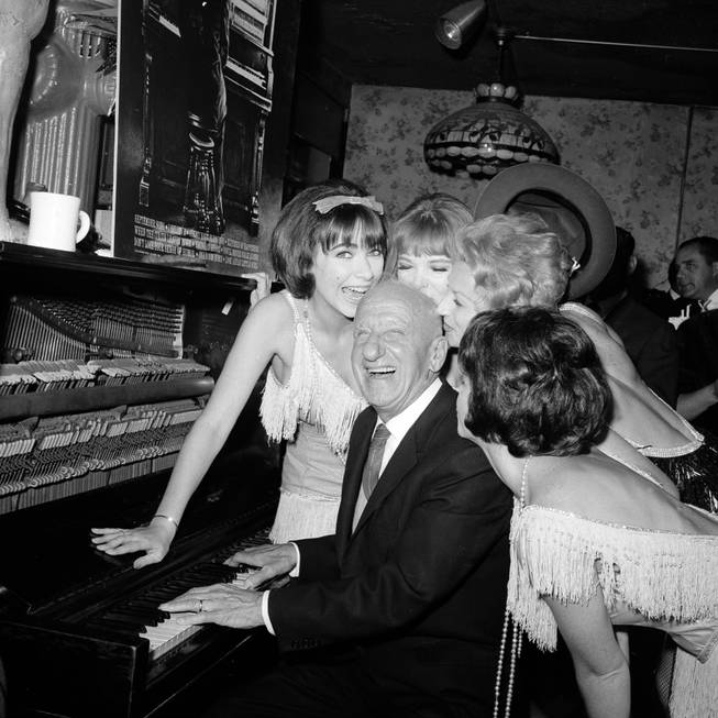 Jimmy Durante is greeted by performers at the Gaslight Club where he celebrates his 50 years in show business in New York City, Sept. 30, 1963.
