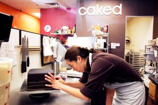 Carolyn Portuondo, owner of Caked Las Vegas, works on a birthday cake at her bakery on Wednesday, Aug. 31, 2011.