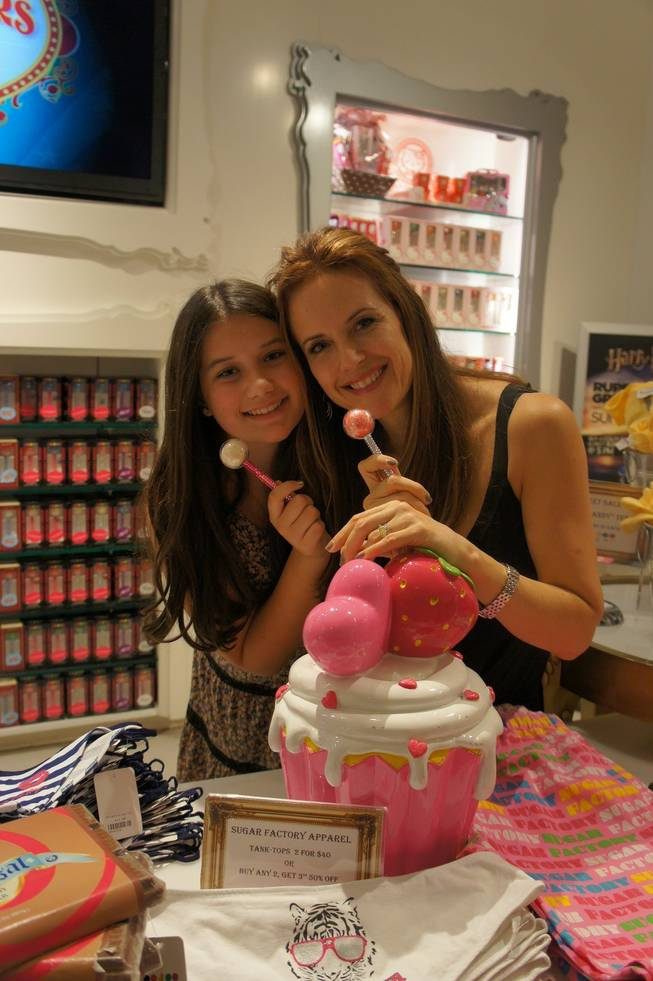 Kelly Preston and daughter Ella Bleu at Sugar Factory in the Paris.