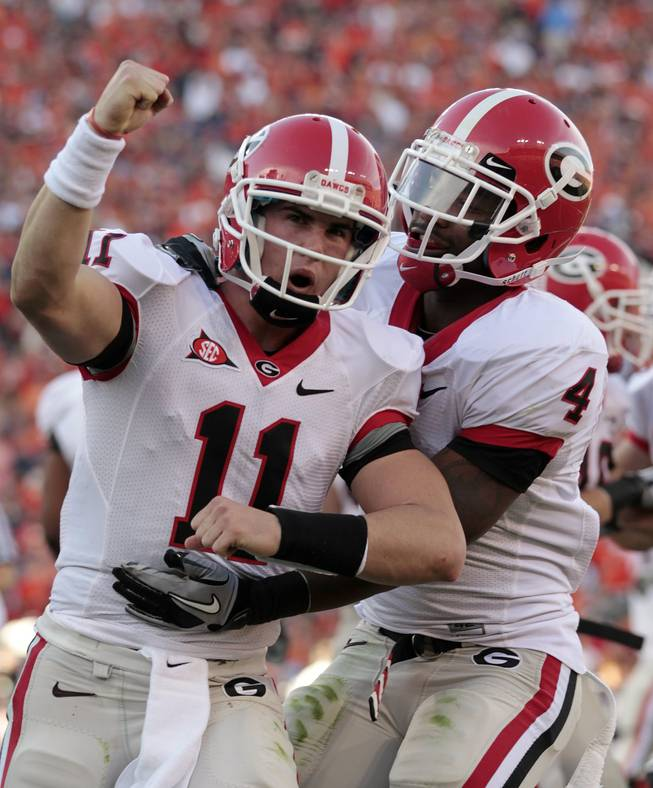 Georgia quarterback Aaron Murray (11) reacts with teammate Caleb King (4) after a first half Bulldog score against Auburn in an NCAA college football game at Jordan-Hare Stadium in Auburn, Ala., Saturday, Nov. 13, 2010.