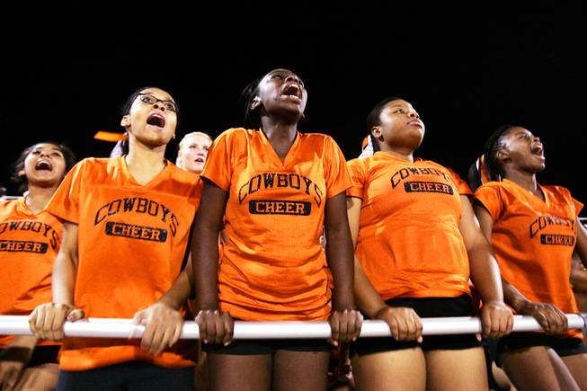 Cheerleaders Elsha Harris, a senior, from left, sophomore Zaakirah Muhammad, sophomore Trynice Gordon and junior Quiana Forbes cheer for the team during Chaparral High School's first football game at Moapa Valley High School in Overton Friday, September 2, 2011.