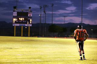 Chaparral player James Bryant pauses during the first quarter of Chaparral High School's first football game against Moapa Valley High School in Overton Friday, September 2, 2011.