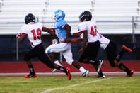 Centennial running back Jacobi Owens gets a big gain against the  Las Vegas defense for a touchdown during their game Friday, September 2, 2011 at Centennial High School. .  Las Vegas came from behind for a 24-21 win.