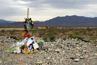 A memorial for 15-year-old Alyssa Otremba is shown near Grand Teton Drive and Tee Pee Lane Monday, September 5, 2011.