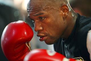 Undefeated welterweight boxer Floyd Mayweather Jr. works out with a heavy bag at the Mayweather Boxing Club Tuesday September 6, 2011. Mayweather challenges WBC welterweight champion Victor Ortiz for the WBC title at the MGM Grand Garden Arena Saturday, September 17.