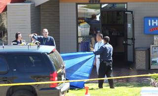 Officials investigate the scene of a shooting in an IHOP restaurant in Carson City on Tuesday, Sept. 6, 2011.