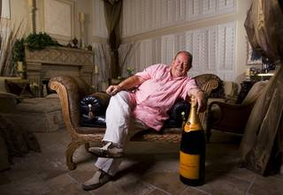 Robin Leach poses at his home in Las Vegas Wednesday, Sept. 7, 2011.