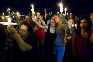 Samantha Forecki, 15, center, and her mother, Michele Enk, hold up candles during a vigil for 15-year-old Alyssa Otremba at Arbor View High School Wednesday, Sept. 7, 2011.  Otremba, an Arbor View sophomore and school band member, was found slain on Saturday, Sept. 3, 2011.
