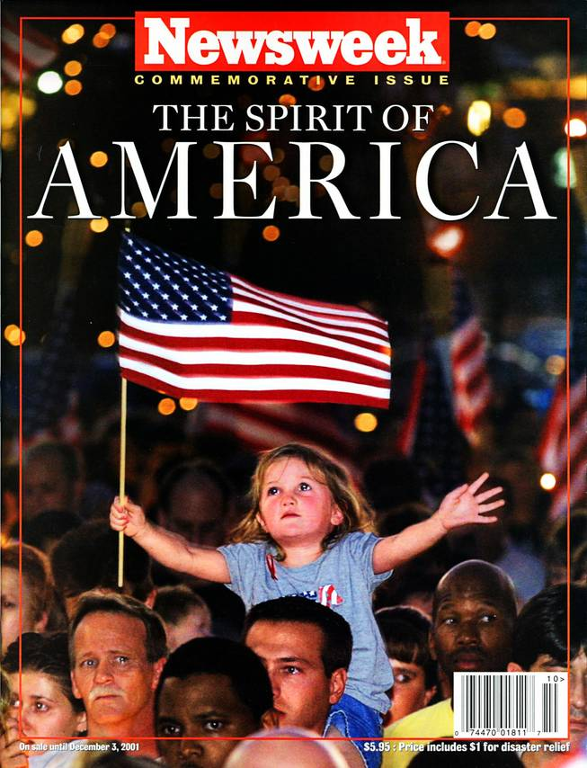 Cover of Newsweek, commemorative issue, released on Sept. 20, 2001. Original cutline reads: Alana Milawski, 3, waves an American flag as she sits on her father Craig Milawski's shoulders during a candlelight vigil at the Thomas & Mack Center Wednesday, September 12, 2001 held to honor those killed in Tuesday's terrorist attacks. ETHAN MILLER / LAS VEGAS SUN